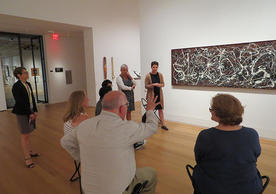 people sitting in front of Jackson Pollock painting