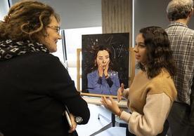 student presenting art