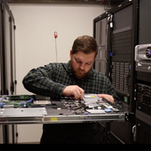 person working on computer server