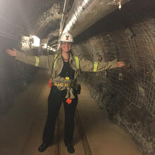 picture of scientis in tunnel with hard hat.