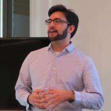 headshot of scientist presenting