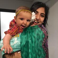 Scientist holding baby.