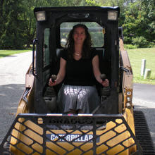 Person driving front loader