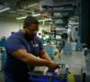 person working in machine shop